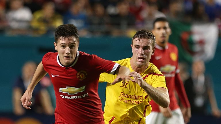 Ander Herrera  of Manchester United in action with Jordan Henderson of Liverpool during a pre-season friendly match