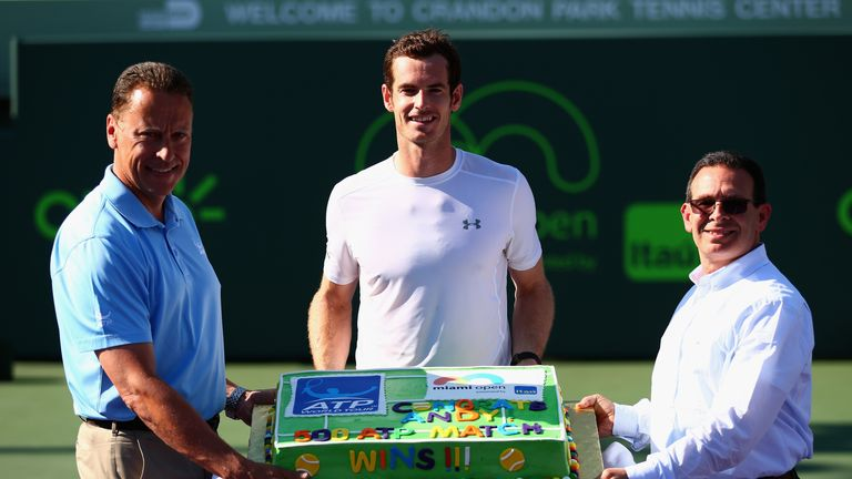 Andy Murray of Great Britain poses with a cake for his 500th ATP Tour victory against Kevin Anderson of South Africa