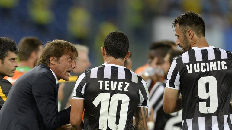 Head coach FC Juventus Antonio Conte, Carlos Tevez and Mirko Vucinic during the TIM Supercup match against Lazio in August 2013