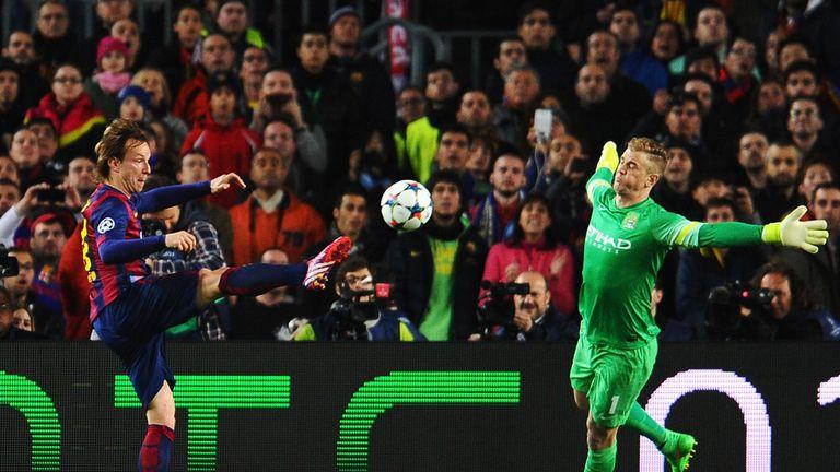 Ivan Rakitic of Barcelona scores the opening goal past Joe Hart of Manchester City