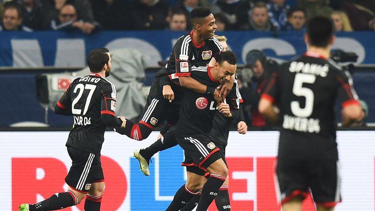Karim Bellarbi of Bayer 04 Leverkusen is congratulated after scoring