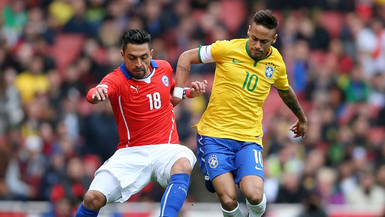 Gonzalo Jara of Chile and Brazil's Neymar compete for the ball during the international friendly between Brazil and Chile