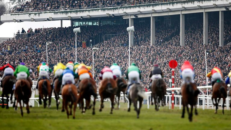A general view as runners race up the straight at Cheltenham racecourse on March 12