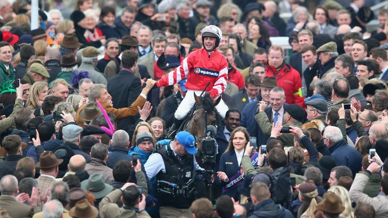 Nico de Boinville riding Coneygree celebrates as he enters the winners enclosure after victory in the Betfred Cheltenham Gold Cup