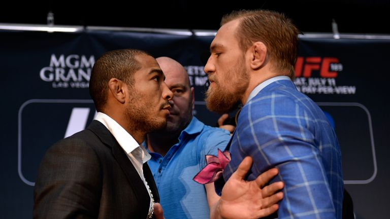 Aldo (l) and McGregor face-off in Toronto