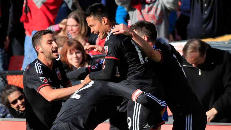 Jairo Arrieta #19 of D.C. United celebrates with teammates after scoring a second half goal against the Montreal Impact during