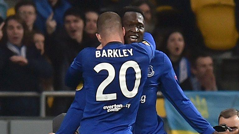 Everton's Belgian forward Romelu Lukaku (back) celebrates with English midfielder Ross Barkley