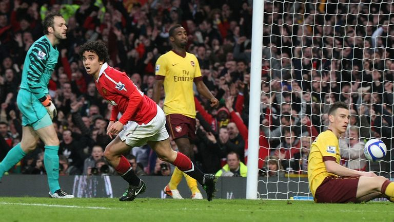 Fabio Da Silva of Manchester United celebrates scoring their first goal during the FA Cup quarter final against Arsenal at Old Trafford in March 2011