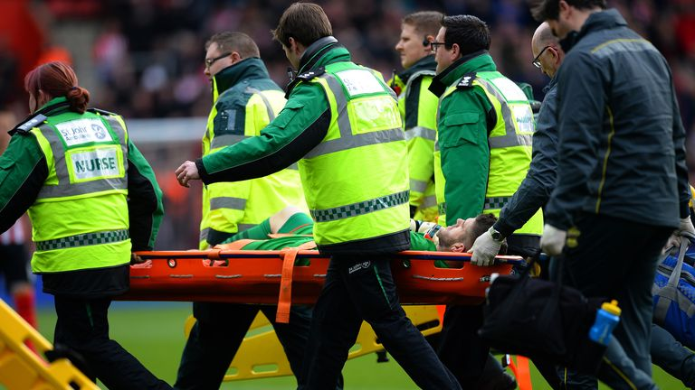 Fraser Forster of Southampton is stretched off the pitch