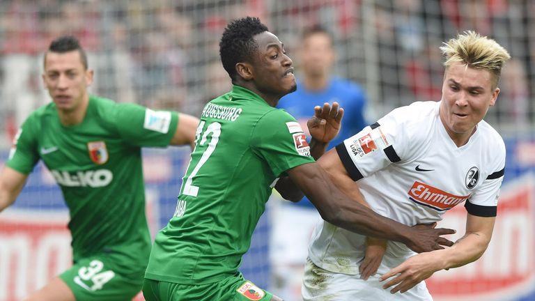Felix Klaus (R) of SC Freiburg challenges Abdul Rahman Baba of FC Augsburg