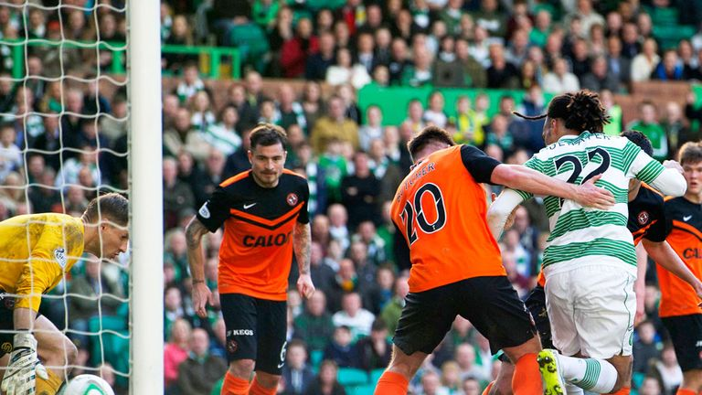 Jason Denayer scores Celtic's third goal against Dundee United