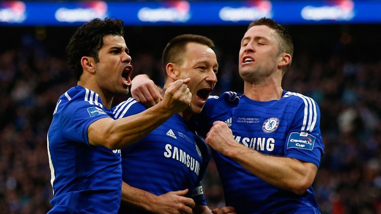 John Terry of Chelsea celebrates scoring the opening goal with Diego Costa and Gary Cahill