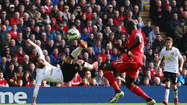 Juan Mata scores his second goal against Liverpool at Anfield
