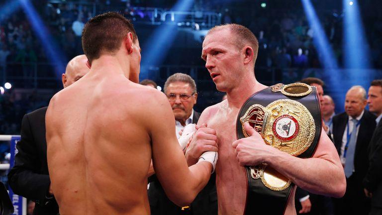 Juergen Braehmer consoles Robin Krasniqi after defending his WBA light heavyweight title