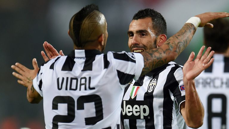 Tevez celebrates with Arturo Vidal