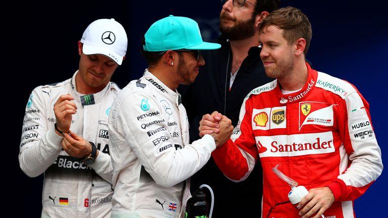 Lewis Hamilton: Celebrates with Sebastian Vettel as Nico Rosberg watches on