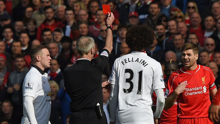 Liverpool's Steven Gerrard is shown a red card by referee Martin Atkinson against Manchester United