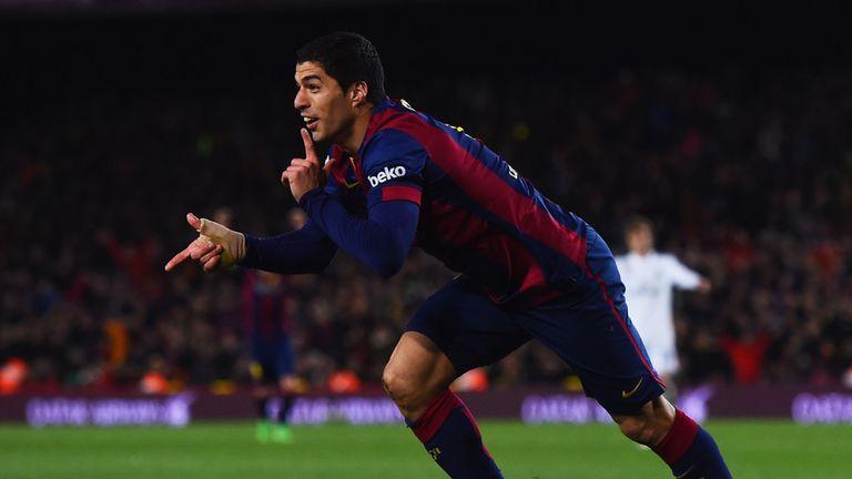 Luis Suarez celebrates his winner