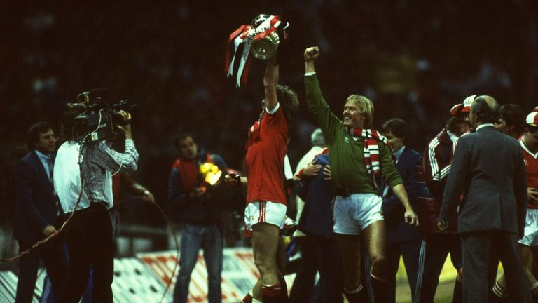 Gordon McQueen and Gary Bailey of Manchester United celebrate after the FA Cup final replay against Brighton and Hove Albion at Wembley Stadium in 1983