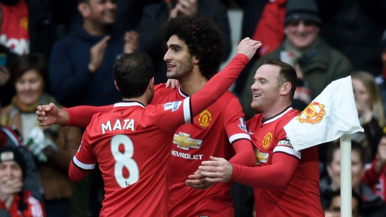 Marouane Fellaini scores the opening goal in United's 3-0 win over Tottenham