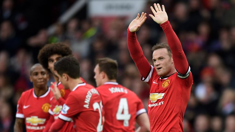Wayne Rooney of Manchester United celebrates after scoring his team's third goal during the Barclays Premier League match with Tottenham