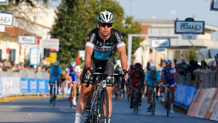 Mark Cavendish rolled over the line after shedding his chain
