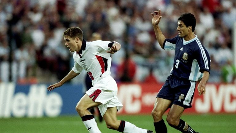 30 Jun 1998:  Michael Owen of England shrugs off Jose Chamot of Argentina on his way to goal during the World Cup second round match at the Stade Geoffroy