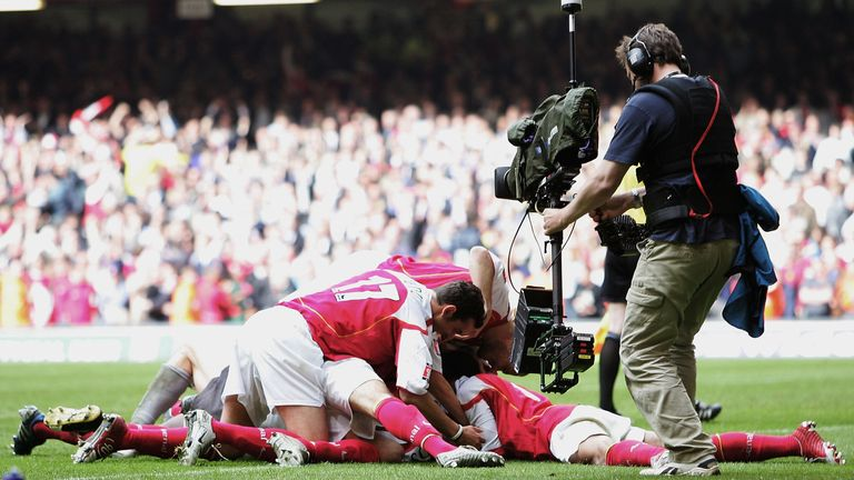 The Arsenal team celebrate Patrick Vieira scoring the last penalty after winning the FA Cup Final between Arsenal and Manchester United in 2005