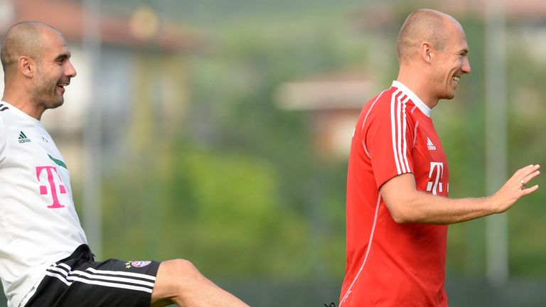 Guardiola and Robben joking during their first training session in 2013