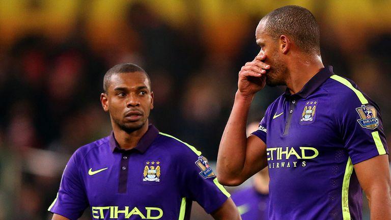 Vincent Kompany of Manchester City speaks with team-mate Fernandinho
