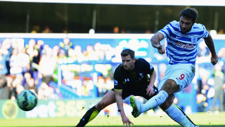 Charlie Austin of QPR shoots as Jan Vertonghen of Spurs looks on during the Barclays Premier League match in March 2015
