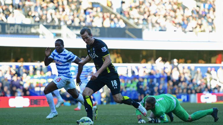 Harry Kane of Spurs beats goalkeeper Robert Green of QPR as he scores their second goal during the Barclays Premier League in March 2015