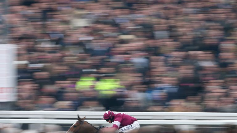 Don Poli ridden by Bryan Cooper races clear to win the RSA Chase on Ladies Day during the Cheltenham Festival at Cheltenham Racecourse.