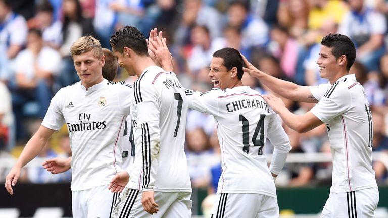LA CORUNA, SPAIN - SEPTEMBER 20:  Chicharito Hernandez (2ndR) of Real Madrid CF celebrates with his teammates after scoring his team's seventh goal during