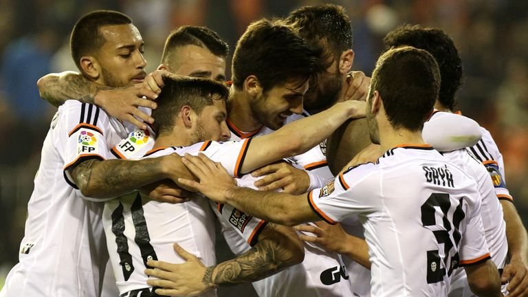 Valencia's players celebrate their second goal