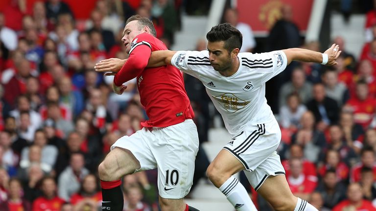 Wayne Rooney of Manchester United in action with Jordi Amat of Swansea City