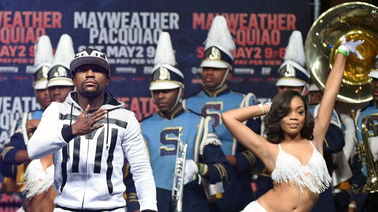 LAS VEGAS, NV - APRIL 28:  WBC/WBA welterweight champion Floyd Mayweather Jr. (L) gestures as he arrives at MGM Grand Garden Arena
