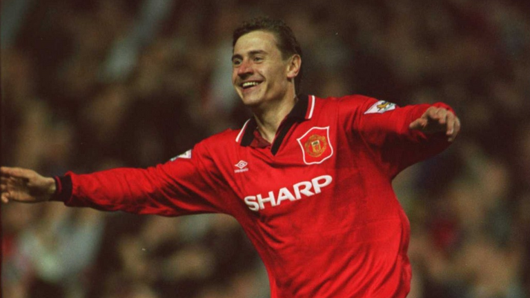Andrei Kanchelskis celebrated the second of his three goals for Manchester United against Manchester City in a 5-0 win at Old Trafford in November 1994
