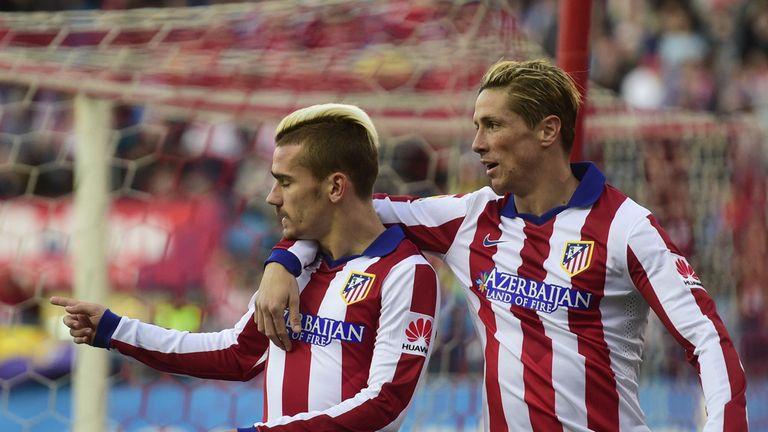 Antoine Griezmann celebrates with Fernando Torres