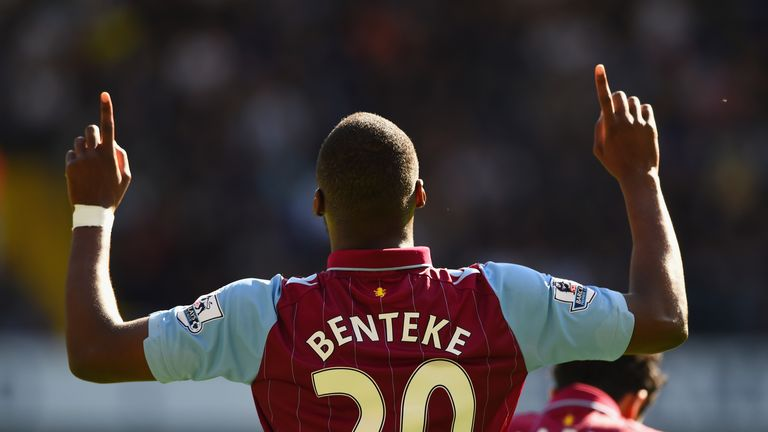 Christian Benteke of Aston Villa celebrates scoring the opening goal against Tottenham