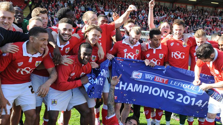 Bristol City's players celebrate winning the league during the Sky Bet League One match at Ashton Gate, Bristol.