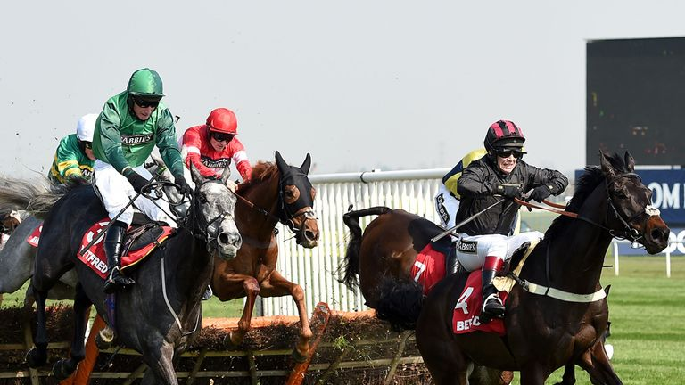 All Yours (red hat centre) goes on to win the Betfred Anniversary 4-Y-O Juvenile Hurdle Race