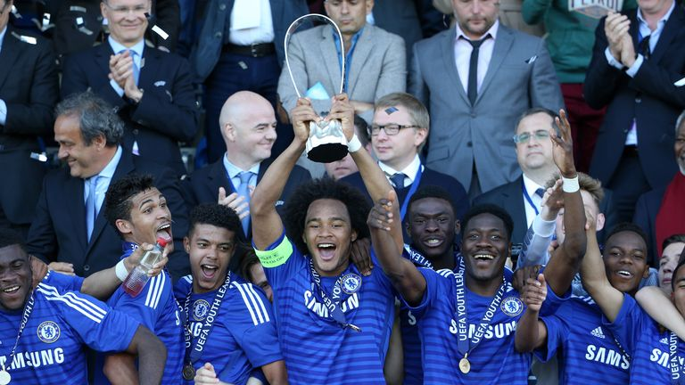 Isaiah Brown of Chelsea lifts the UEFA Youth League trophy