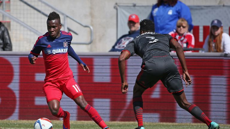 BRIDGEVIEW, IL - APRIL 04: David Accam #11 of the Chicago Fire moves around Warren Creavalle #3 of Toronto FC during an MLS match at Toyota Park on April 4