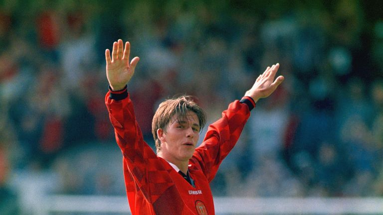 David Beckham celebrates after scoring from the halfway line, during the Premier League match between Wimbledon and Man Utd at Selhurst Park in 1996