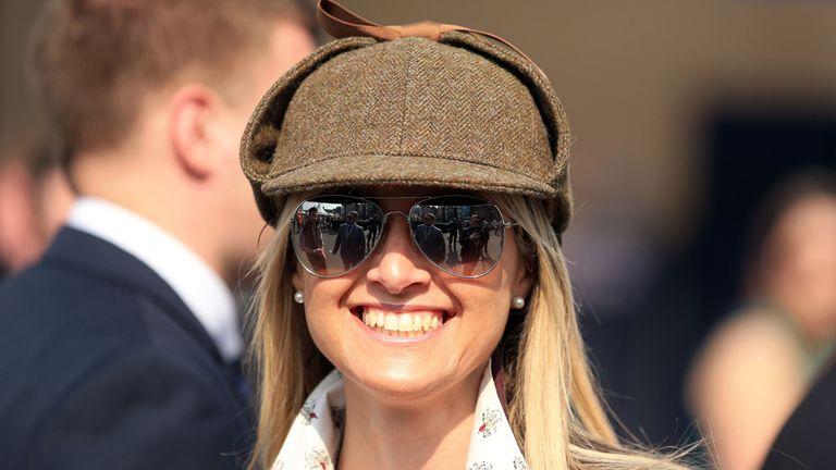 A female racegoer wearing a deerstalker hat