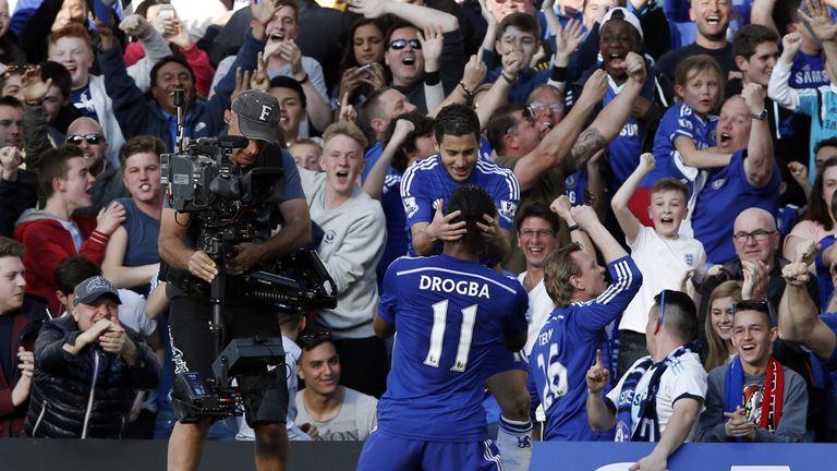 Eden Hazard celebrates scoring with Didier Drogba