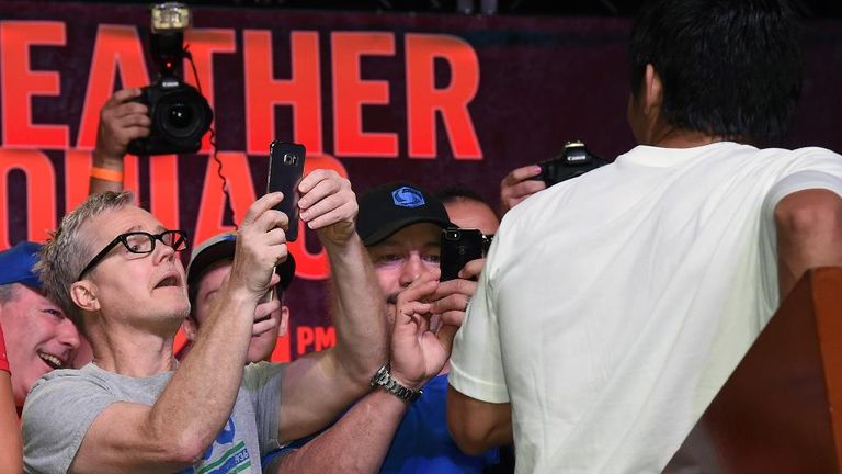 Freddie Roach and WBO welterweight champion Manny Pacquiao during a fan rally at the Mandalay Bay Convention Center on April 28, 2015 in Las Vegas