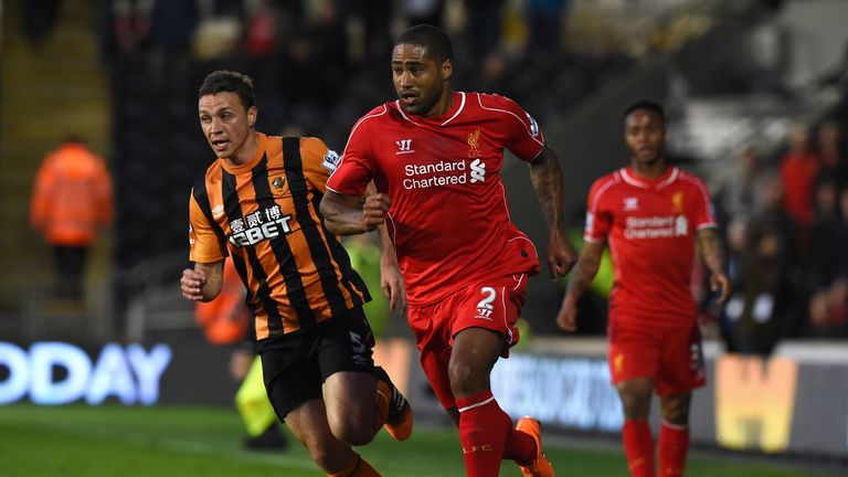Liverpool's English defender Glen Johnson (C) runs with the ball tracked by Hull City's English defender James Chester (L)