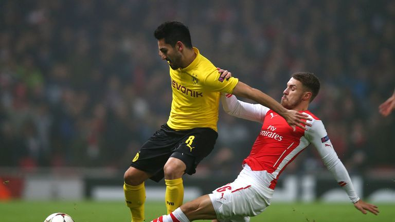 Gundogan in action with Arsenal's Aaron Ramsey during a Champions League clash